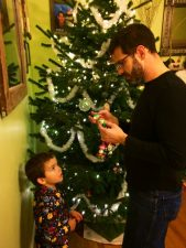 Taylor family decorating a Christmas tree 2015 2