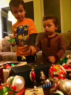 Our kids love sorting through ornaments to decorate a Christmas tree. A wonderful family tradition. 2traveldads.com