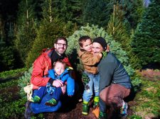 Taylor family getting tree from Christimas Tree farm. Sustainable, local business support. Christmas traditions.