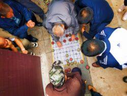 Old Men playing Chinese game in street Baoji China 2