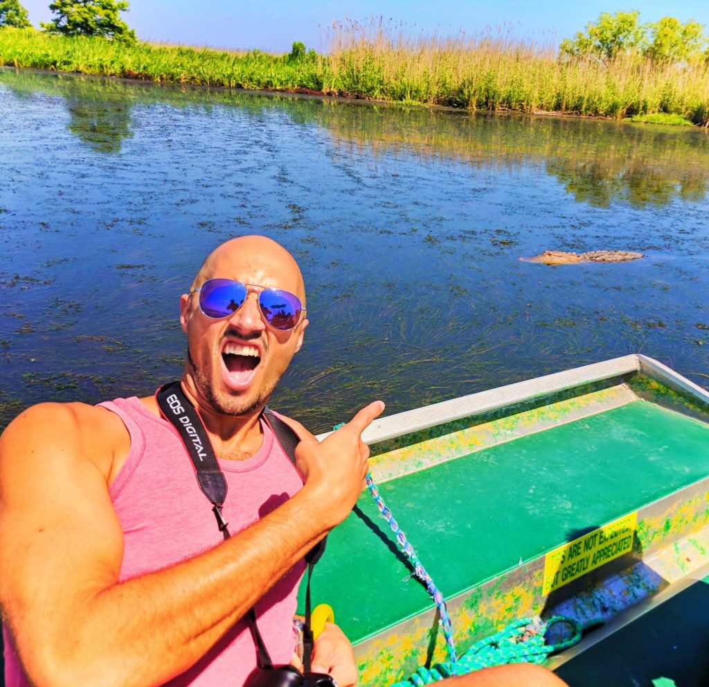 Rob-Taylor-and-alligator-on-Airboat-in-Mobile-Delta-1-1024x991.jpg