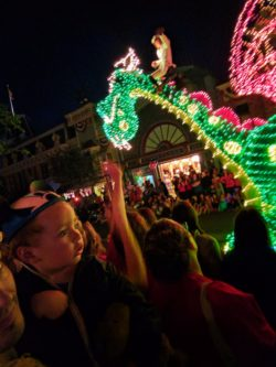 Taylor Family and Petes Dragon float Main Street Electrical Parade Disneyland at night 2