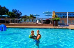 Taylor Family at swimming pool at Hyatt House Anaheim Disneyland 2