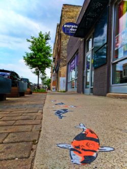 Purple Door Ice cream and koi fish street art in Historic Third Ward Downtown Milwaukee 1