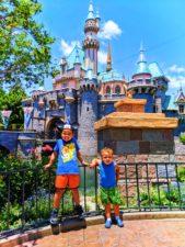 Taylor-Family-in-front-of-Sleeping-Beauty-Castle-Disneyland-1-169x225.jpg
