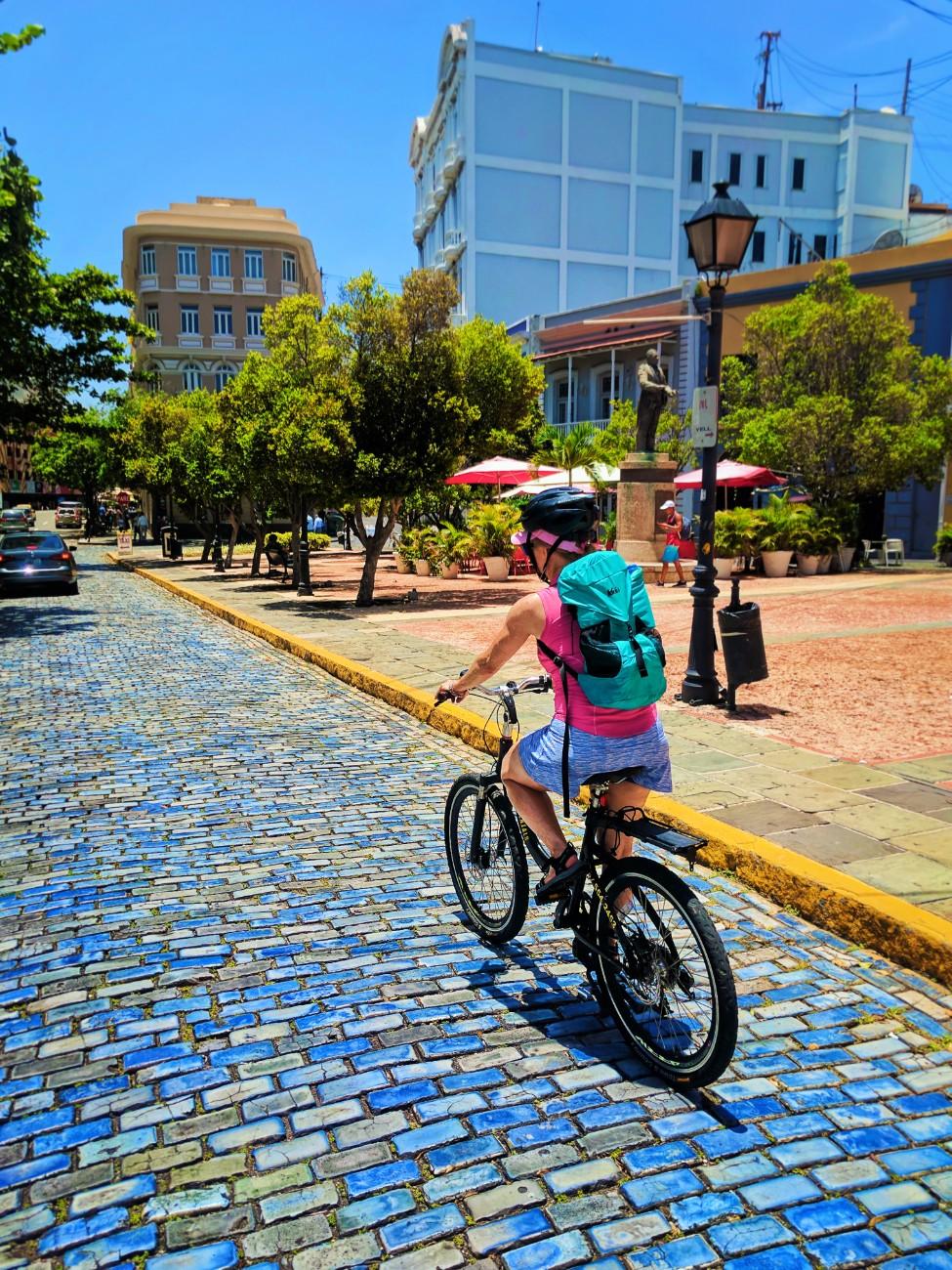 Maureen biking through Plaza Malecon in Old San Juan Puerto Rico 1