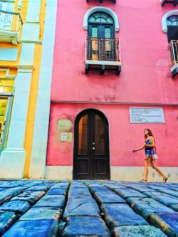 Woman with Colorful row houses in Old San Juan Puerto Rico 3