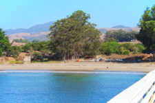 Cove and kayaks from pier at Hearst San Simeon California State Park 1