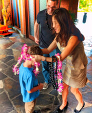 Taylor Family arriving at Disney Aulani receiving leis