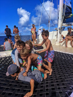 Taylor family and friends playing on catamaran off Oahu 1