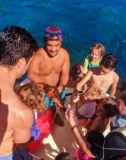 Taylor family on catamaran with octopus off Oahu 4