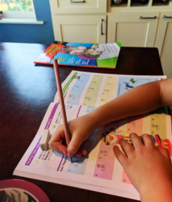 Taylor Family doing Math workbooks WorldSchooling 7