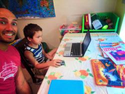 Taylor Family doing writing workbooks WorldSchooling 2