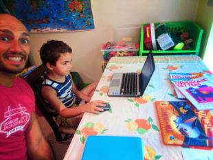 Taylor Family doing writing workbooks WorldSchooling 2