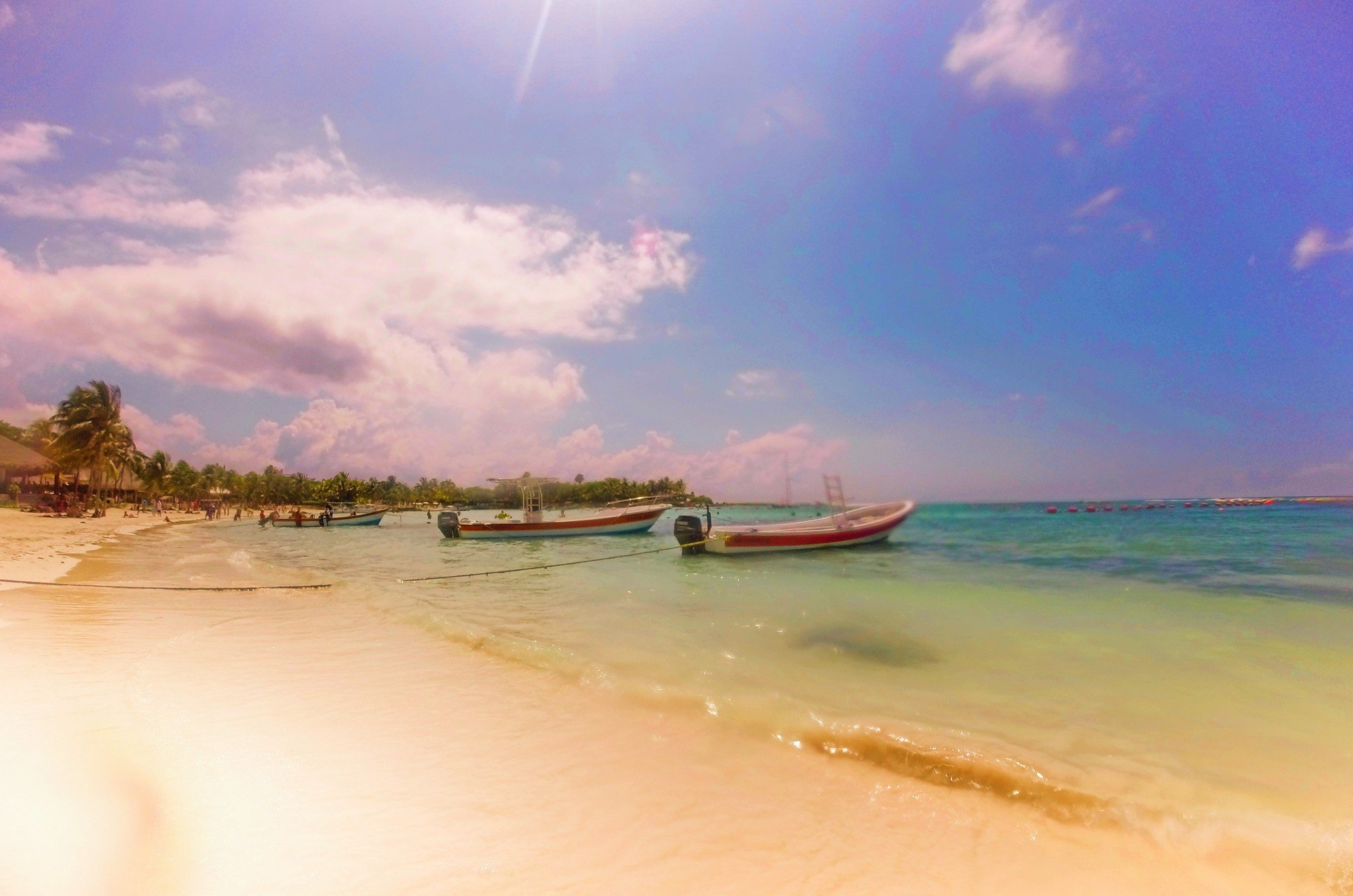 Boats on Caribbean beach Yucatan Mexico