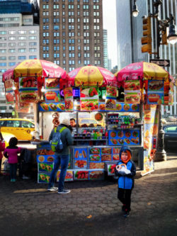 Taylor Family eating pretzels in Uptown Manhattan Pretzel cart 2