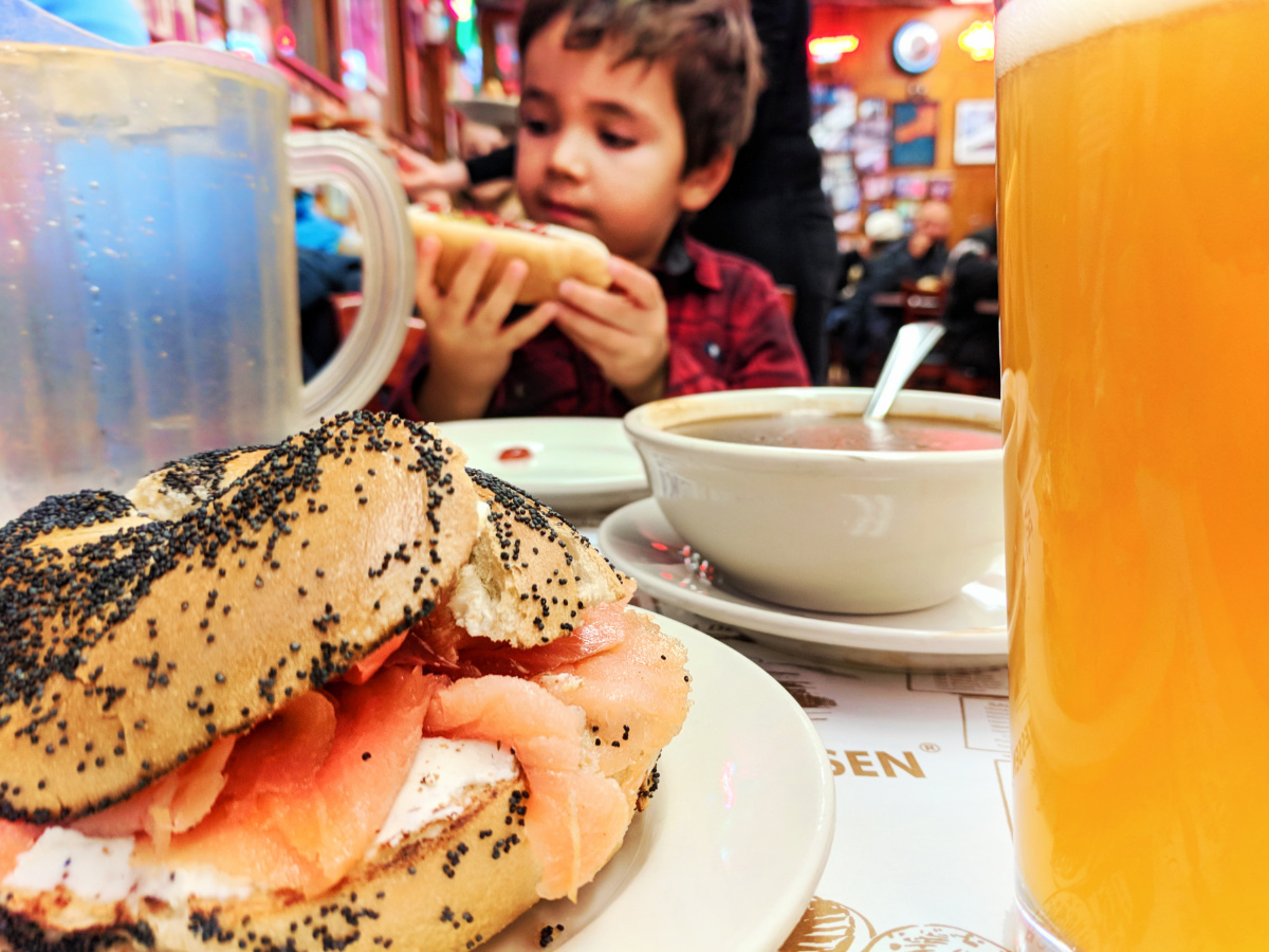Taylor Family with Lox on poppy seed bagel at Katzs Delicatessen NYC with Kids 1