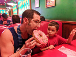 Taylor Family eating Big Pink Donut in Simpsons area Universal Studios Florida 4