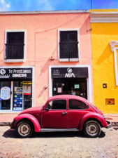 VW Bug and Colorful buildings on sidestreet in Valladolid Yucatan road trip 11