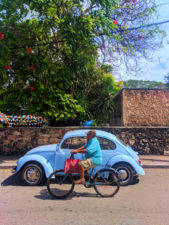 VW Bug and Colorful buildings on sidestreet in Valladolid Yucatan road trip 14