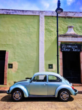 VW Bug and Colorful buildings on sidestreet in Valladolid Yucatan road trip 6