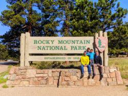 Taylor Family at Entrance Sign Rocky Mountain National Park Colorado 2