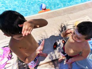 Taylor Family with sunblock by pool at Universal Cabana Bay Resort Orlando Florida 1