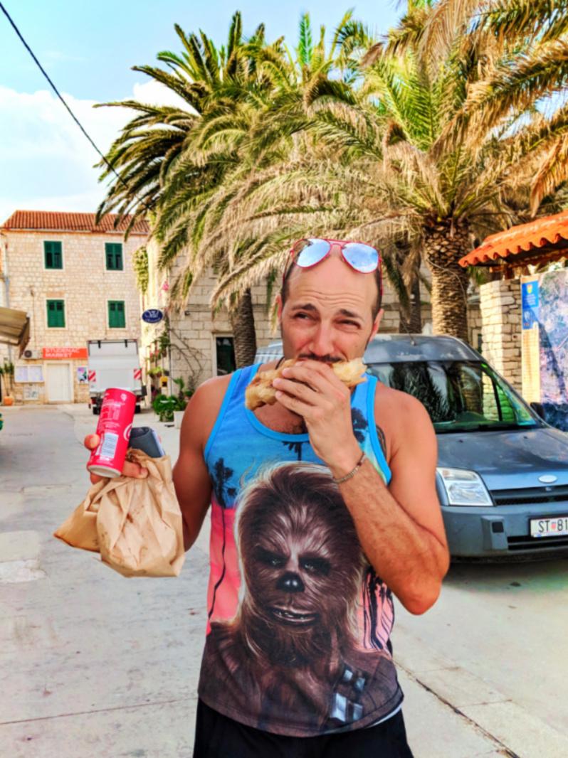 Rob Taylor eating meat pie in Vis Croatia 1