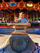 Taylor Family pulling the Sword in the Stone Fantasyland Disneyland
