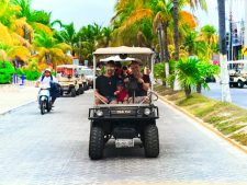 FIAL Frank and BJ in golf cart Isla Mujeres Quintana Roo Mexico 1