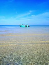 Boat in Turquoise water on beach at Isla Holbox Yucatan 1