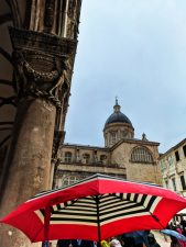 Cathedral and red umbrella in the Rain Old Town Dubrovnik Croatia 1
