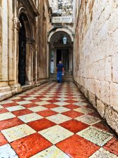 Checker alleyway heading to Franciscan Monastary Cloister Museum Old Town Dubrovnik Croatia 1