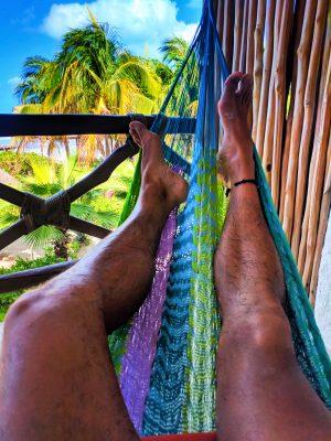 Rob Taylor in hammock on balcony at sunrise Villas Flamingos Isla Holbox Yucatan 1