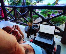 Rob Taylor with Laptop on balcony at sunrise Villas Flamingos Isla Holbox Yucatan 1