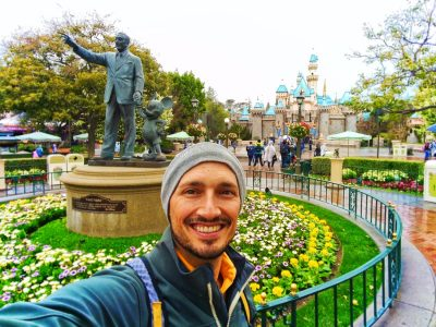 Rob-Taylor-with-Partners-Statue-and-Castle-in-Disneyland-1-400x300.jpg