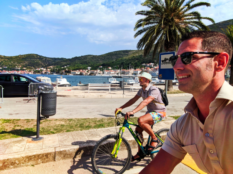 Chris and Rob Taylor riding bikes around cove in Vis Croatia 5