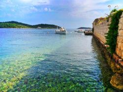 Colorful water at city wall Port of Vis Croatia 1