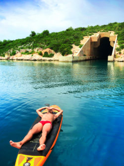 Rob Taylor on paddleboard at submarine silo Pride Sailing Holidays at Vis Croatia 1