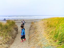 Taylor Family crossing sand dunes at Westport Light State Park Westport Washington Coast 2