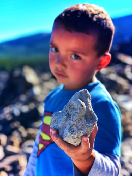Elliott Taylor holding pumice rock at Big Obsidian Flow Newberry Caldera Bend Oregon 1