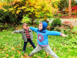 Taylor family with fall colors doing yoga Suquamish 2