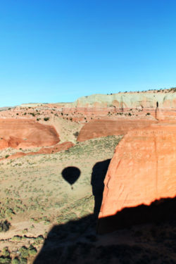 Morning hot air ballooning shadows over Red Rocks Park Gallup NM 13