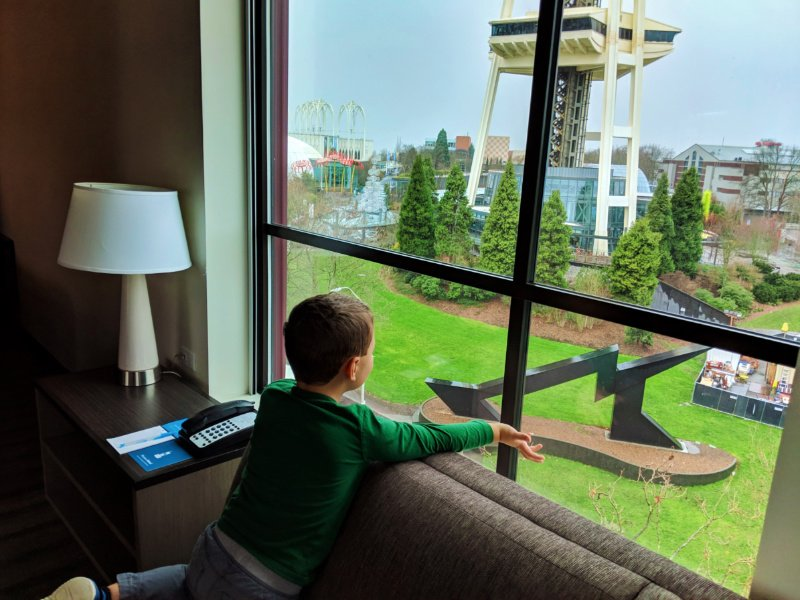 Taylor Family and Space Needle through living room windows at Hyatt House Seattle 1