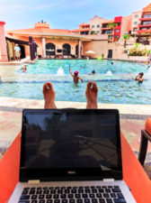 Blogging-at-computer-by-pool-at-Playa-Grande-Cabo-San-Lucas-1-168x225.jpg