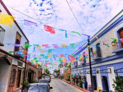 Colorful flags off plaza in Todos Santos Baja California Sur 5