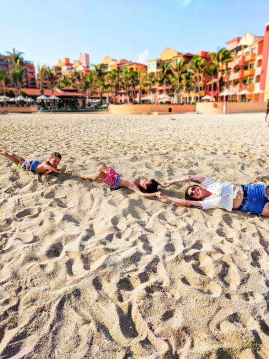 Sarah Richard and Taylor kids rolling in sand at Playa Grande Cabo San Lucas Mexico 1