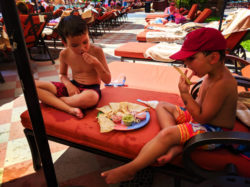 Taylor Family eating lunch by Pool at Playa Grande Resort Cabo San Lucas 1