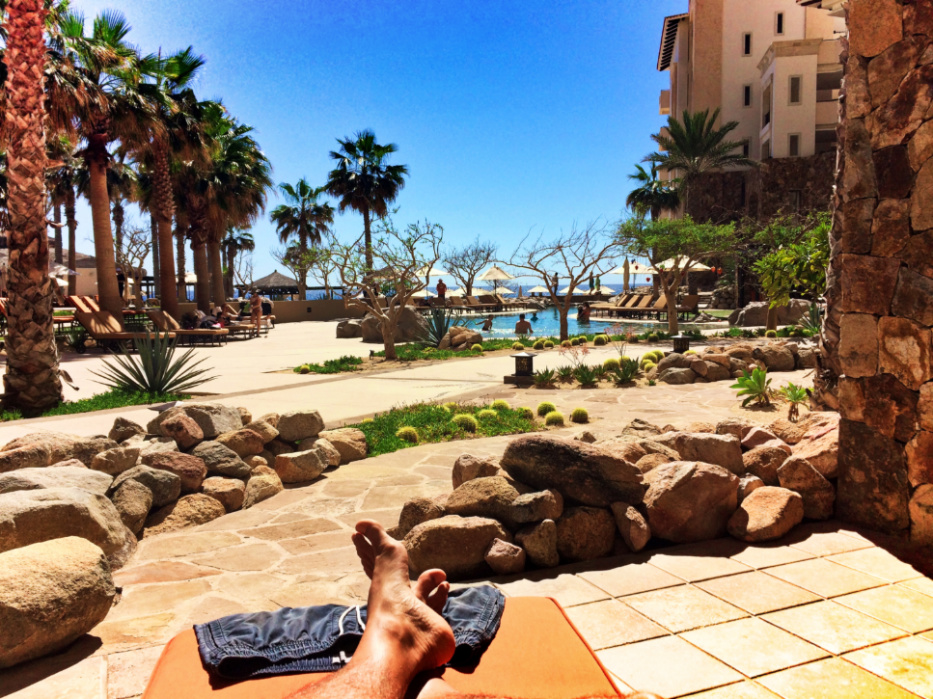 Taylor Family relaxing on patio with pools at Grand Solmar Resort Cabo San Lucas 2