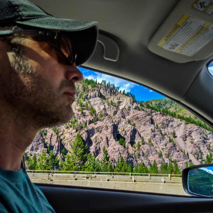 Chris Taylor driving past rocky cliffs rural Montana 1